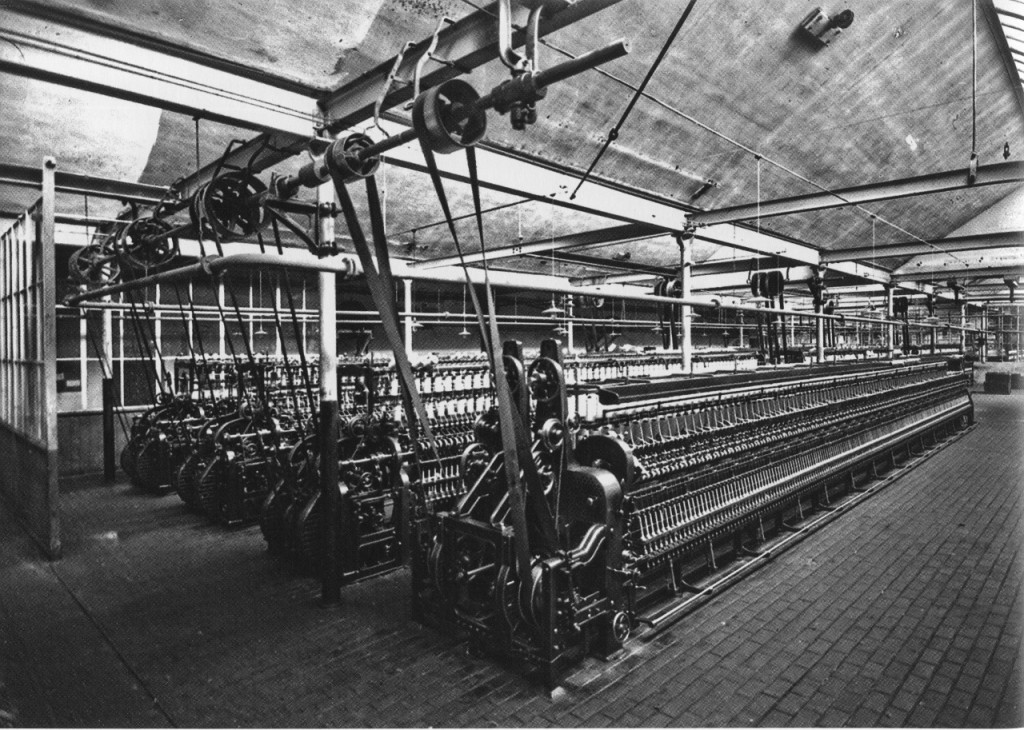 Four wool spinning machines driven by belts from an overhead lineshaft (Leipzig, Germany, circa 1925)